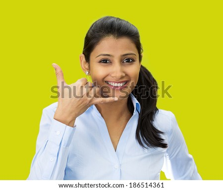 Closeup portrait, beautiful young woman showing call me phone hand sign gesture, smiling, happy, isolated green background. Positive human emotion facial expression feelings, body language, symbols - stock photo