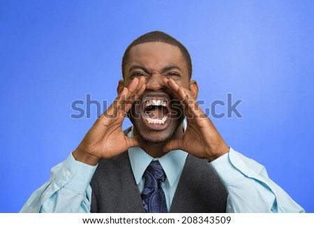 Closeup portrait bitter mad, displeased pissed off, angry grumpy corporate man, open mouth, hands in air, screaming, yelling isolated blue background. Negative human emotion facial expression feeling - stock photo