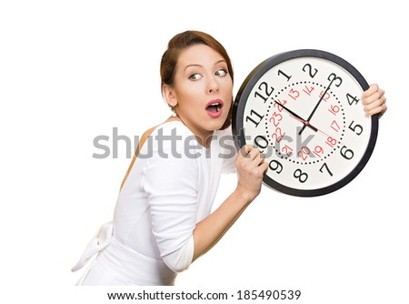 Closeup portrait boss, woman, worker, holding clock looking anxiously, pressured by lack, running out of time, isolated white background, clipping path. Human face expression, emotion, reaction - stock photo