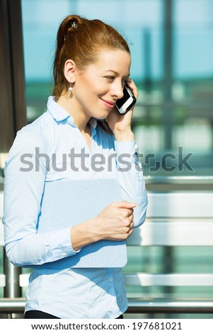 Closeup portrait business woman talking on mobile phone. Businesswoman on cellphone running while talking on smart phone. Happy smiling corporate employee isolated background office building windows - stock photo