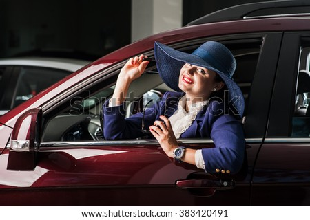 Closeup portrait, cheerful, joyful, smiling, beautiful business lady holding up keys to her first new business class car. - stock photo