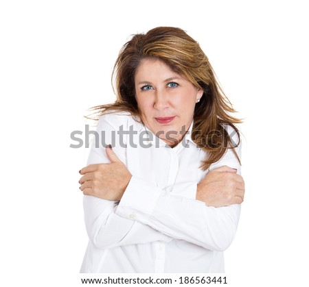 Closeup portrait, confident, mature woman holding hugging herself, isolated white background. Positive human emotion facial expression feeling, reaction, situation, attitude. Love yourself concept - stock photo