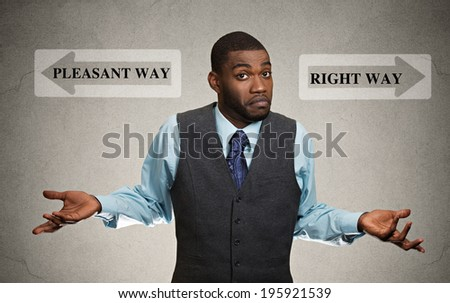 Closeup portrait confused, clueless looking man, arms out, shrugging shoulders, not sure which way to go in life isolated black background with arrows, right, pleasant. Emotions, facial expressions - stock photo