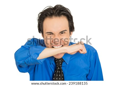 Closeup portrait crazy looking young mad man going nuts biting wrist arm in neurotic nervous manner isolated white background. Negative human emotion facial expression feeling. Mental illness concept  - stock photo