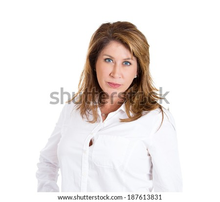 Closeup portrait, displeased, pissed off, angry, grumpy, mature woman with bad attitude, looking at you, isolated white background. Negative human emotion, facial expression feeling