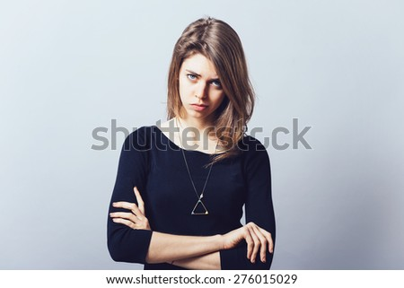 Closeup portrait displeased pissed off angry grumpy pessimistic woman with bad attitude, arms crossed looking at you Negative human emotion facial expression feeling - stock photo