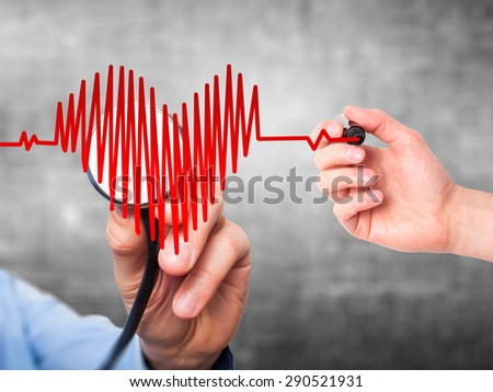 Closeup portrait doctor hand listening to heart beat in heart shape with stethoscope isolated on grey background. Preventive medicine concept  - stock photo