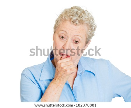 Closeup portrait elderly woman, old corporate employee, confused grandmother, melancholic mood, daydreaming looking clueless sucking up thumb, isolated white background. Human emotion, face expression - stock photo