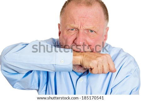 Closeup portrait, employee worker, senior mature man person looking at you and biting arm in neurotic nervous manner, isolated white background. Negative human emotion facial expressions feelings. - stock photo