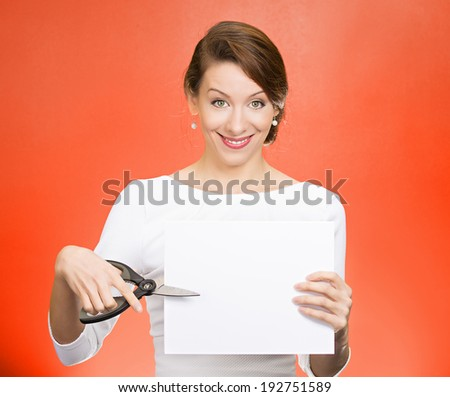 Closeup portrait, excited, happy, energetic enthusiastic young business woman, funny female, worker, dedicated employee cutting blank white paper, copy space with scissors isolated red background. - stock photo