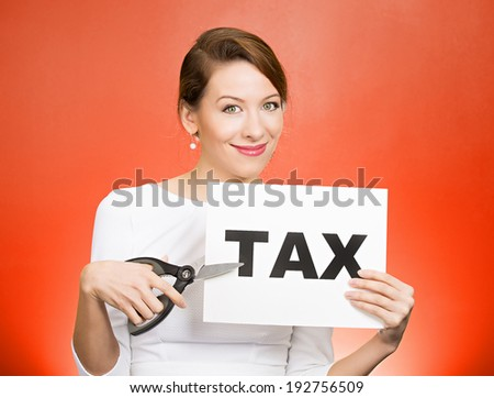 Closeup portrait excited, happy, smiling, energetic, enthusiastic young business woman, funny looking girl, worker, dedicated employee, cutting taxes with scissors, isolated red background. IRS. - stock photo