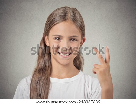 Closeup portrait excited, happy successful teenager girl giving number two, peace, victory sign, isolated grey background. Positive emotion face expression attitude, reaction, perception body language - stock photo