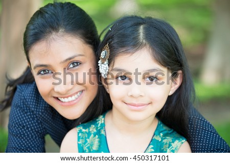 Closeup portrait, family looking at camera, isolated outdoors outside background - stock photo