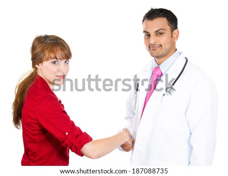 Closeup portrait, friendly health care professional with stethoscope, shaking hands with happy patient, isolated white background.  Contract, agreement, confidentiality - stock photo