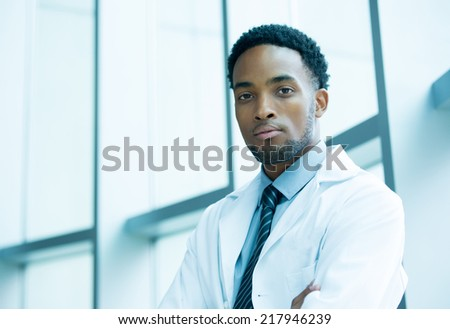 Closeup portrait friendly, kind confident male doctor, arms crossed, healthcare professional with a white coat, isolated hospital clinic background - stock photo