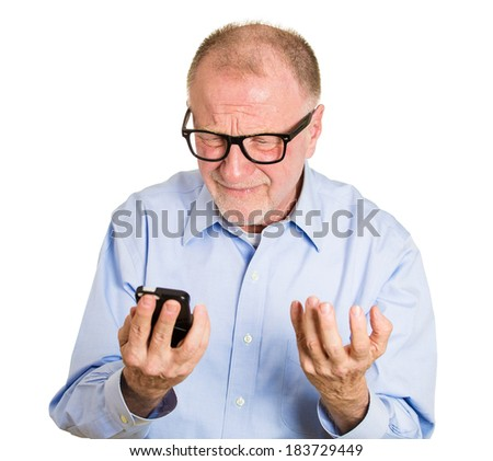 Closeup portrait, frustrated angry senior man, nerd black glasses, seeing bad news email text on cellphone, isolated white background. Negative human facial expressions, emotion feeling - stock photo