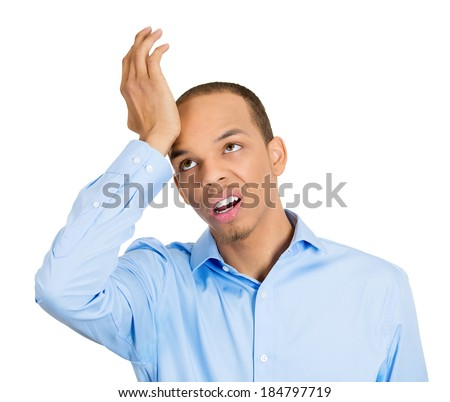 Closeup portrait, goofy funny face man slapping hand on head to say duh, isolated white background. Negative human emotion facial expression feelings, body language - stock photo