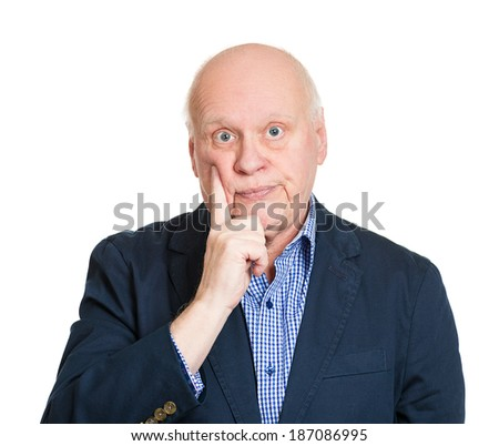 Closeup portrait, goofy senior mature man, finger on cheek, bored out of mind, annoyed by you talking, isolated white background. Negative emotion facial expression feelings, reaction, attitude - stock photo