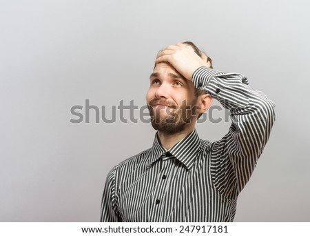 Closeup portrait, goofy, silly young man, slapping hand on head . Negative human emotion facial expression feelings, body language