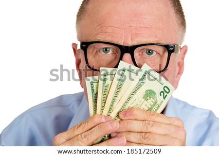 Closeup portrait, greedy senior executive, CEO, boss, old corporate employee, mature man, eyes above dollar notes in front of face isolated white background. Negative human emotion facial expression