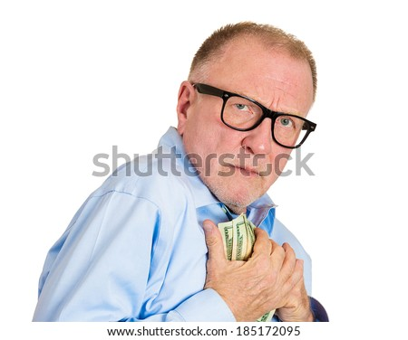Closeup portrait, greedy senior executive, CEO, boss, old corporate employee, mature man, holding dollar banknotes tightly, isolated white background. Negative human emotion facial expression - stock photo