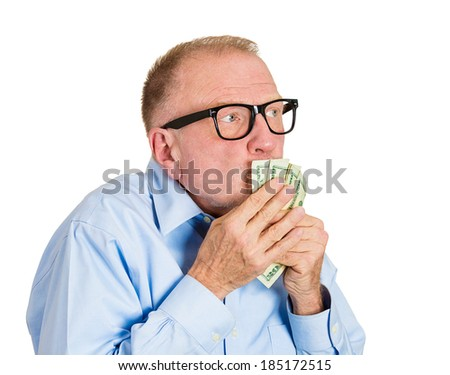 Closeup portrait, greedy senior executive, CEO, boss, old corporate employee, mature man, holding, kissing dollar banknotes tightly, isolated white background. Negative human emotion facial expression - stock photo
