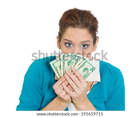 Closeup portrait greedy young woman, corporate business employee, worker, student, holding dollar banknotes tightly, isolated white background. Negative human emotions, facial expressions, feelings - stock photo