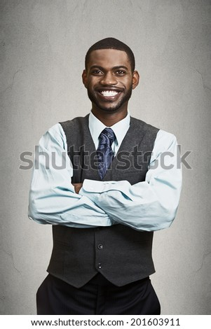 Closeup portrait handsome happy, young, smiling business man with arms crossed, confident student agent, entrepreneur isolated black grey background. Positive face expression emotion feeling, attitude - stock photo