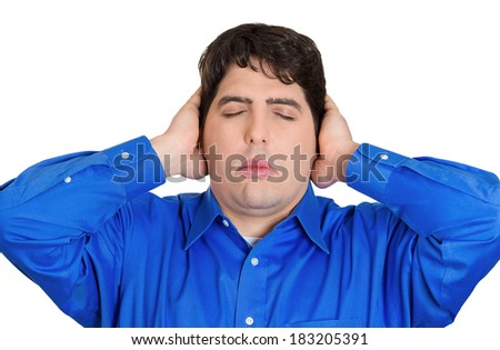 Closeup portrait handsome peaceful, tranquil, looking relaxed, young business man covering his ears, closing eyes, isolated white background. Hear no evil concept. Human emotion, facial expressions - stock photo
