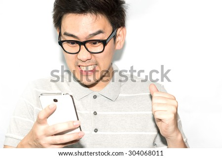 Closeup portrait handsome young Asian man. Positive human emotions, facial expression, feelings. - stock photo