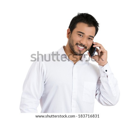 Closeup portrait, handsome young business man, student, happy guy, excited employee, using cell phone, smiling, having pleasant conversation, isolated white background. Human emotions, expression - stock photo