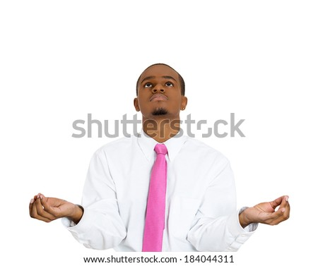 Closeup portrait handsome young man, looking up, in meditation zen mode, isolated white background. Stress relief techniques concept. Positive human emotions, facial expression sign, feelings - stock photo
