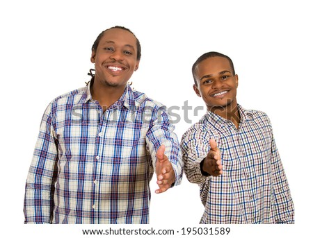 Closeup portrait handsome young smiling men giving, extending arms for handshake at camera gesture isolated white background. Positive human emotions, facial expressions, feelings, life perception