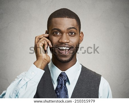 Closeup portrait happy business man talking on mobile phone, isolated grey wall background. Positive human facial expressions, emotions, feelings, life perception, attitude, thinking - stock photo