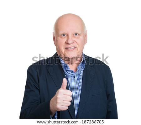 Closeup portrait, happy, confident, cheerful, smiling senior mature man showing thumbs up sign gesture, isolated white background. Positive human emotions, facial expressions, feelings, attitude - stock photo