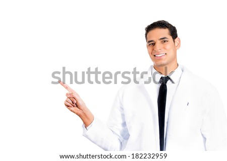 Closeup portrait happy, confident male healthcare professional, dentist, doctor, nurse, assistant pointing at copy space isolated white background. Positive human face expressions, emotions, attitude - stock photo
