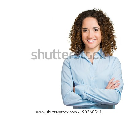 Closeup portrait, happy, confident, successful, pretty young woman in blue shirt with arms crossed folded, isolated white background. Positive human emotions, facial expressions, feelings, attitude