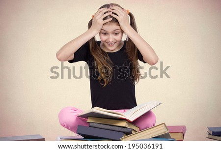 Closeup portrait happy, excited, smiling, funny looking little girl, surprised, shocked, reading book, discovered something new, isolated brown background. Human facial expressions, emotions, feeling - stock photo