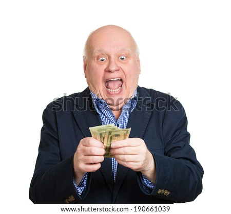Closeup portrait, happy, excited successful senior lucky elderly man holding money dollar bills in hand isolated white background. Positive emotion facial expression feeling. Financial reward savings - stock photo