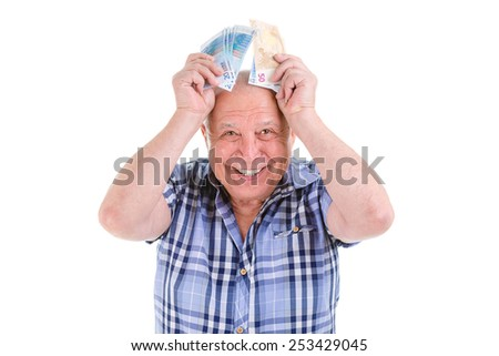 Closeup portrait, happy, excited successful senior lucky elderly man holding money euros banknotes in hands isolated white background. Positive emotion facial expression feeling. Reward savings - stock photo