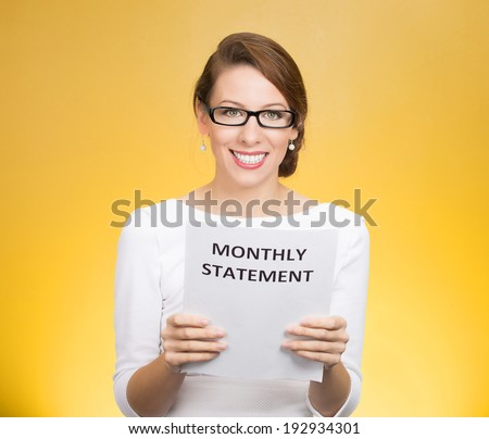 Closeup portrait happy excited young business woman looking at monthly statement glad to pay off bills, isolated yellow background. Positive emotions, facial expressions. Financial success, good news
