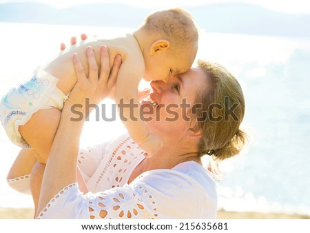 Closeup portrait happy grandmother smiling baby, grandson, head to head isolated outdoors ocean, lake, sea background. Positive human emotions, facial expressions, feelings. Family, happiness concept - stock photo