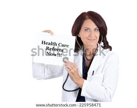 Closeup portrait happy health care professional, doctor, nurse, with stethoscope holding  health care reform now sign isolated on white background. Government, politics, universal insurance debate - stock photo
