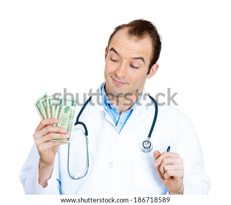 Closeup portrait, happy, sarcastic health care professional, business man doctor holding dollar bills, cash, money in hand, isolated white background. Human emotions facial expressions, attitude - stock photo