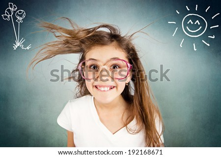 Closeup portrait happy, smiling , excited, funny looking little girl with big glasses, messy hair, isolated dark blue background with son, flowers. Positive human emotion, facial expression, attitude  - stock photo