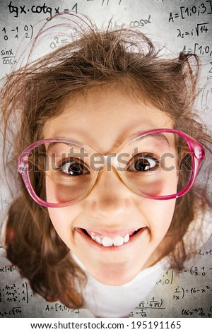 Closeup portrait happy, smiling , excited, funny looking, little girl with big glasses, messy hair, background with math formulas. Positive human emotions, facial expressions, attitude, reaction - stock photo