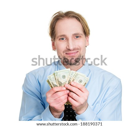 Closeup portrait happy, smiling excited successful business man, holding dollar bills isolated white background. Positive human emotions, facial expression feeling. Making spending money