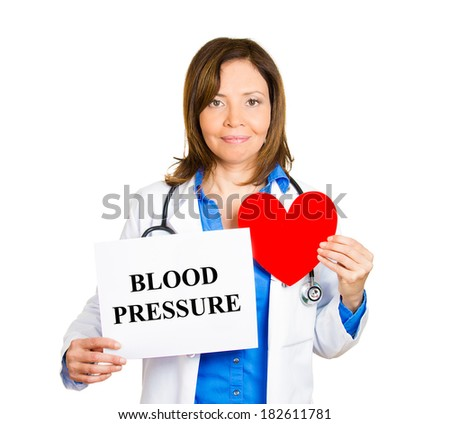 Closeup portrait happy smiling female health care professional, woman family doctor, cardiologist with stethoscope holding sign blood pressure, red heart isolated white background. Patient treatment - stock photo
