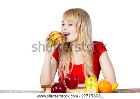 Closeup portrait happy, smiling young, fit female holding, eating vitamin fruit sandwich, burger made of apples, oranges, strawberries, fruits isolated white background. Healthy lifestyle