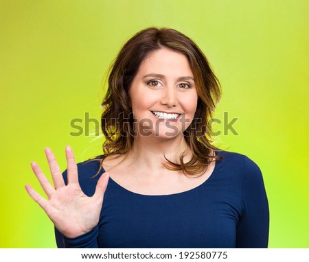 Closeup portrait, happy, smiling young woman making five times sign gesture with hand fingers, isolated green background. Positive human emotion facial expression feelings, attitude, symbol, reaction - stock photo